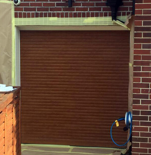 Before garage door refurbishment